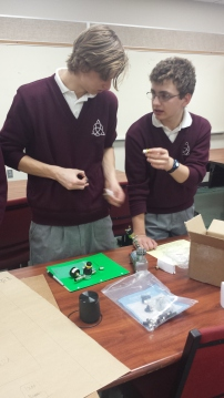 Luca and Jessie discussing pneumatics for the robot