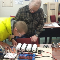 Raymond working with a mentor on the robot
