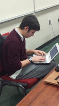 Andrew Medina working hard on the CAD