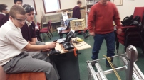 Raymond and Andrew working with mentors on the robot.