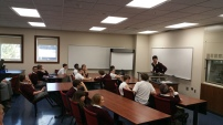 Captain Aaron Telander updates the team on current changes to the design of the robot