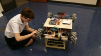 Claire Anderson upgrading the wheels of the robot