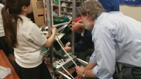 Members of the build team setting up the rack and pinion