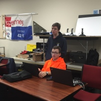Members of CAD creating the design of the robot