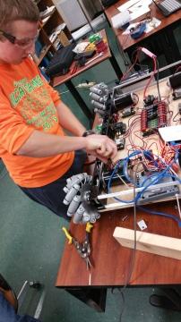 Build members building the robot