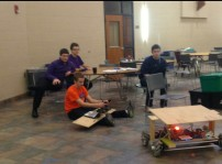 Members of the team driving the robot