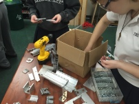 Mebmbers of Build organizing parts for this year's robot