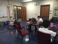 Members of Programming working on last years robot
